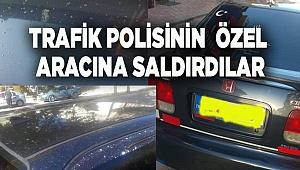 TRAFİK POLİSİNİN ÖZEL ARACINA SALDIRDILAR