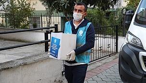 İşyeri kapatan esnaf ve çalışanına gıda kolisi yardımı